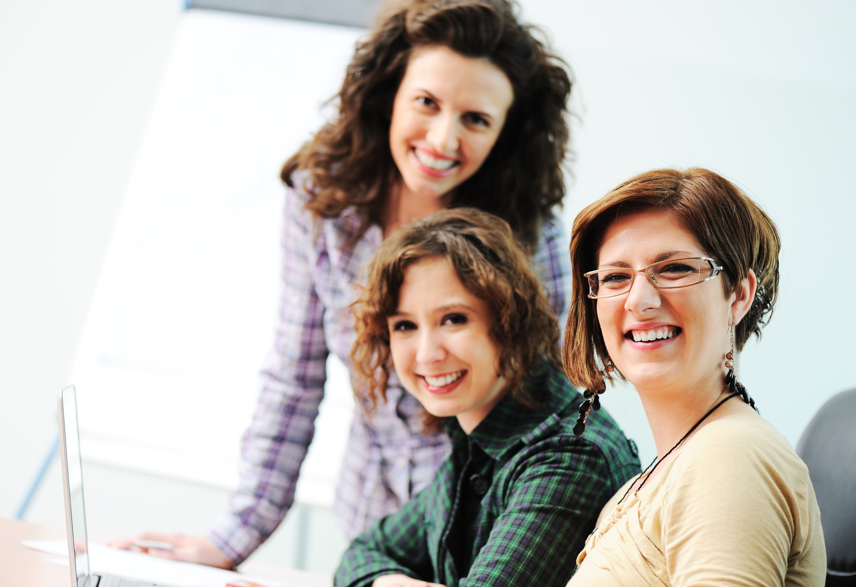stockfresh_1152357_while-meeting-group-of-young-women-working-together-on-the-table_sizeM_169e72.jpg