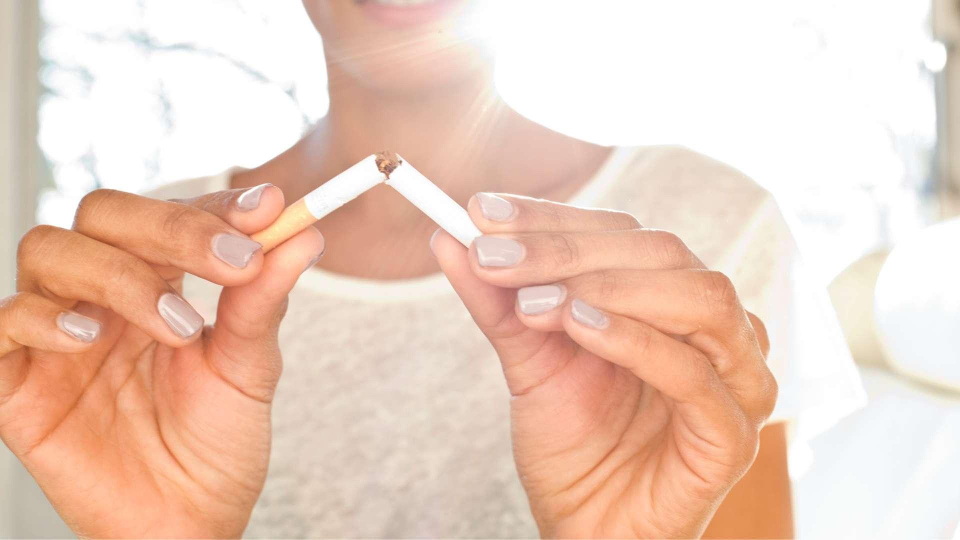 Woman_Breaking_Cigarette_1920x1080.jpg