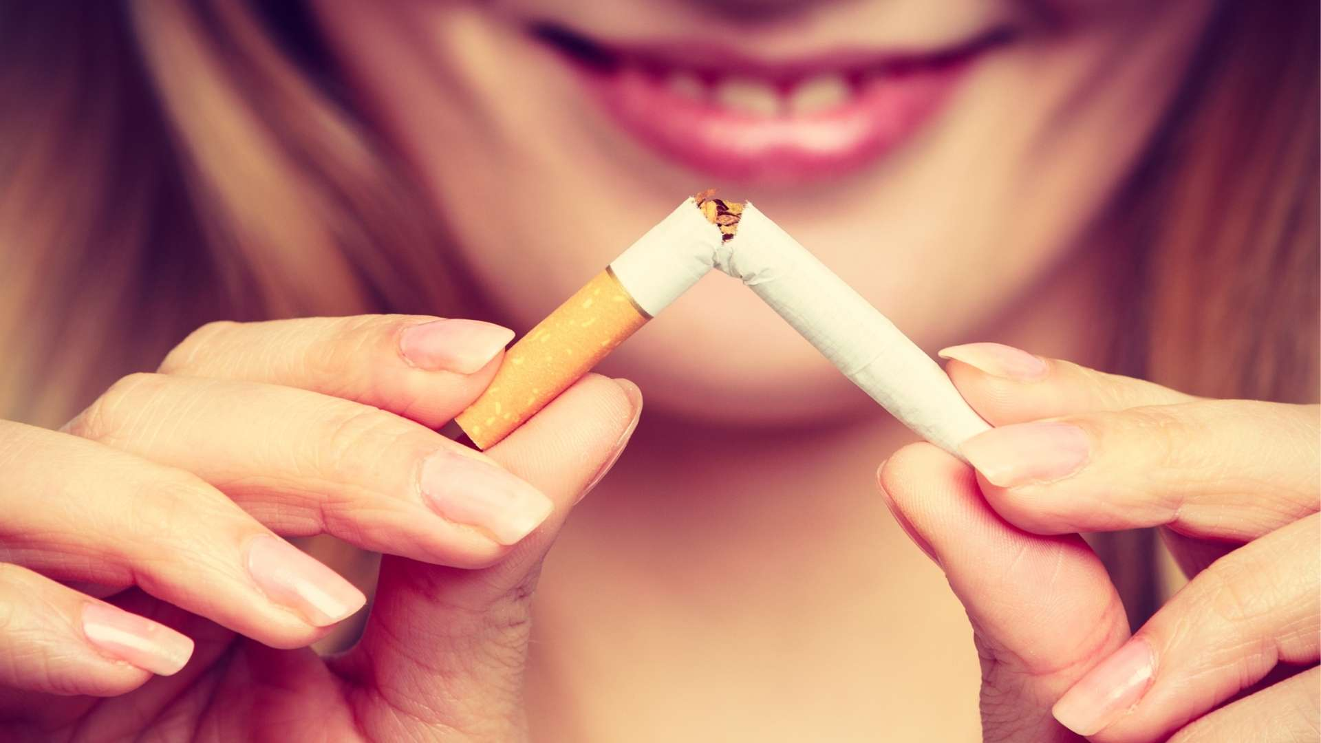 Woman_Breaking_Cigarette_2_1920x1080.jpg